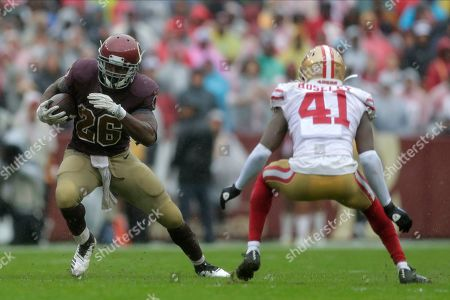 Week 13. Washington Redskins running back Adrian Peterson (26) rushes as San Francisco 49ers defensive back Emmanuel Moseley (41) covers in the first half of an NFL football game, in Landover, Md