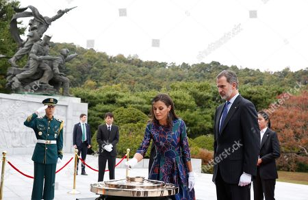 Queen Letizia (C) and King Felipe VI (R) of Spain burn incense to pay tribute to the victims of the Korean War during their visit to the National Cemetery in Seoul, South Korea, 23 October 2019. King Felipe VI and Queen Letizia of Spain arrived in South Korea on a two-day visit to develop the bilateral relationship between the two nations.