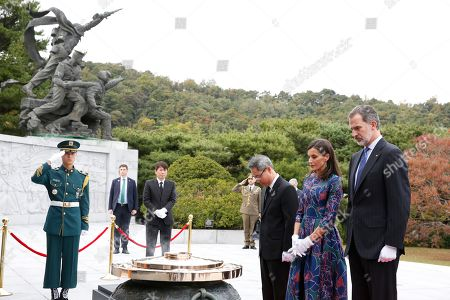 King Felipe VI of Spain (R) and Queen Letizia (2-L) pay tribute to the victims of the Korean War during their visit to the National Cemetery in Seoul, South Korea, 23 October 2019. King Felipe VI and Queen Letizia of Spain arrived in South Korea on a two-day visit to develop the bilateral relationship between the two nations.