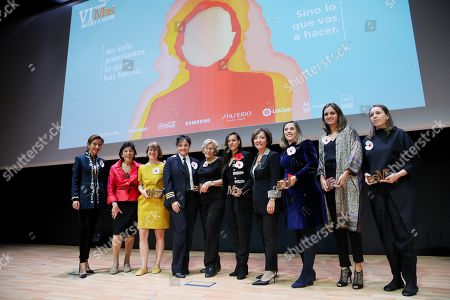 Spanish acting Minister of Education, Isabel Celaa (2-L), poses for a family picture with the award winners during the 5th edition of the More Women to Follow awards in Madrid, Spain, late 22 October 2019 (issued 23 October 2019).