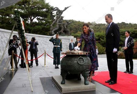 King Felipe VI, Queen Letizia. Spain's King Felipe VI, second from right, stands as his wife Queen Letizia burns incense at the National Cemetery in Seoul, South Korea, . Felipe VI arrived on Wednesday for a two-day visit to meet with South Korean President Moon Jae-in