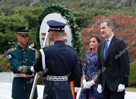 King Felipe VI, Queen Letizia. Spain's King Felipe VI, right, and his wife Queen Letizia stand to carry a wreath at the National Cemetery in Seoul, South Korea, . Felipe VI arrived on Wednesday for a two-day visit to meet with South Korean President Moon Jae-in