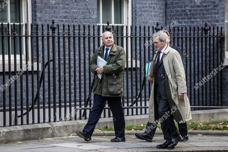 Iain Duncan Smith with Owen Paterson arrive for today's Cabinet Meeting at Downing Street