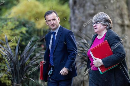 Therese Coffey MP, Secretary of State for Work and Pensions arrives with Alun Cairns MP, Secretary of State for Wales for today's Cabinet Meeting at Downing Street.