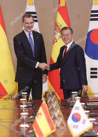 South Korean President Moon Jae-in (R) and King Felipe VI of Spain (L) shake hands at the presidential office in Seoul, South Korea, 23 October 2019. King Felipe VI and Queen Letizia of Spain arrived in South Korea on a two-day visit to develop the bilateral relationship between the two nations.