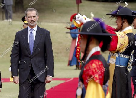 King Felipe VI of Spain (L) inspects an honor guard during a welcome ceremony held in Seoul, South Korea, 23 October 2019. King Felipe VI and Queen Letizia of Spain are on an official two-day visit to South Korea for the first time. They aim to develop the bilateral relationship between the two nations.