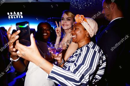 Cara Delevingne (centre) and guests
