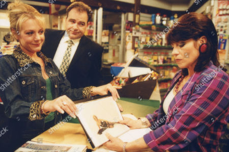 Ep 2954 Friday 6th July 2001 Carol shows off her Miss Naughty Nylons competition photos to a jealous Viv. With Carol Wareing, as played by Helen Pearson ; Terry Woods, as played by Billy Hartman; Viv Hope, as played by Deena Payne.