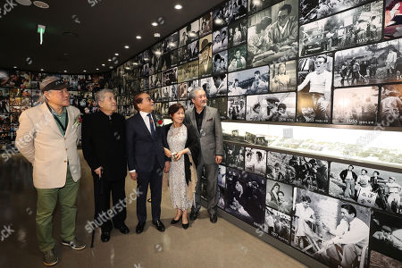 Im Kwon-taek (2-L), and unidentified actors look at a display during the opening of the Danseongsa Korean Film History Museum in Seoul, South Korea, 23 October 2019.