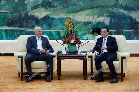 Stock Picture of Chinese Premier Li Keqiang (R) and former United States Secretary of the Treasury Henry Paulson (L) speak during a meeting at the Great Hall of the People in Beijing, China, 23 October 2019.