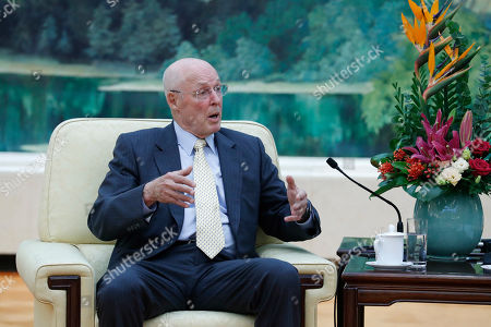 Former United States Secretary of the Treasury Henry Paulson speaks with Chinese Premier Li Keqiang during a meeting at the Great Hall of the People in Beijing, China, 23 October 2019.