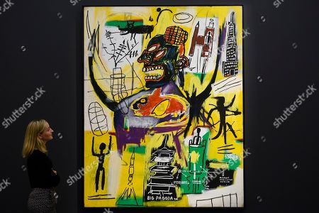 "A staff member views ""Pyro"", 1984, by Jean-Michel Basquiat (Est. above GBP 9m). Preview of Sotheby's Frieze Week Contemporary Art exhibition at its New Bond Street galleries. Over 250 works by artists, including Andy Warhol, David Hockney and Jean-Michel Basquiat, will be auctioned on 3 October 2019."