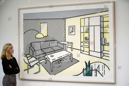 "A staff member views ""Modern Room (Study)"", 1996, by Roy Lichtenstein (Est. GBP 0.5-0.7m). Preview of Sotheby's Frieze Week Contemporary Art exhibition at its New Bond Street galleries. Over 250 works by artists, including Andy Warhol, David Hockney and Jean-Michel Basquiat, will be auctioned on 3 October 2019."