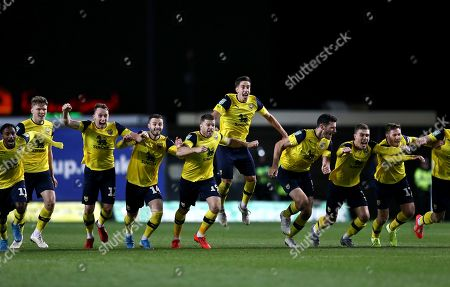 Jamie Mackie of Oxford United celebrates with team-mates  winning penalty shoot-out