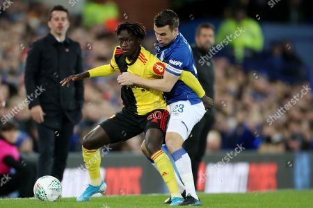 Domingos Quina of Watford is tackled by  Seamus Coleman of Everton