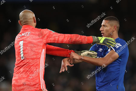 Watford goalkeeper Heurelho Gomes pushes Richarlison of Everton away after the Everton player attempted to speak to him after scoring the second goal