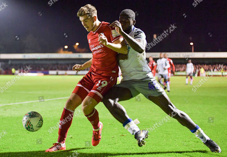 Stock Photo of Ollie Palmer of Crawley Town and Frank Nouble of Colchester United battle for the ball
