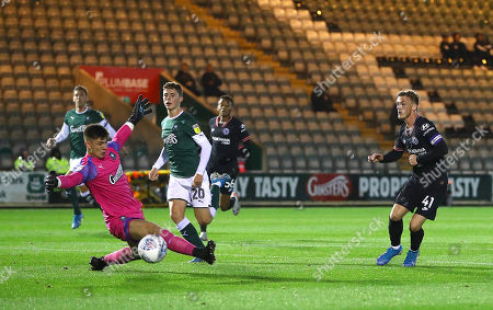 Charlie Brown of Chelsea U21 is denied by Michael Cooper of Plymouth Argyle