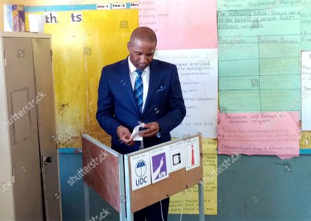 Stock Image of Opposition coalition Umbrella for Democratic Change presidential candidate, Duma Boko, casts his vote in Gaborone . Polls opened in Botswana as the long peaceful southern African nation faces what is expected to be a tight election