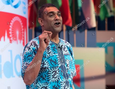 Stock Image of Secretary General of Amnesty International, Kumi Naidoo speaks during a session at the One Young World Summit in the Methodist Hall in London, Britain, 23 October 2019. Over 2,000 young people from over 190 countries gathered for the One Young World Summit, a global forum for young leaders, aiming to create the next generation of more responsible and effective leaders.