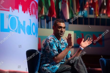 Secretary General of Amnesty International, Kumi Naidoo speaks during a session at the One Young World Summit in the Methodist Hall in London, Britain, 23 October 2019. Over 2,000 young people from over 190 countries gathered for the One Young World Summit, a global forum for young leaders, aiming to create the next generation of more responsible and effective leaders.