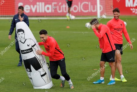 Sevilla FC's forward Munir El Haddadi (L) and midfielders Alejandro Pozo (2-R) and Sergi Lopez (R) attend a team's training session at club's sport complex in Seville, southern Spain, 23 October 2019. Sevilla FC will face Dudelange, from Luxembourg, in a Europa League's A group match at Seville's Ramon Sanchez-Pizjuan Stadium on 24 October.