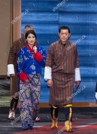 Stock Photo of King Jigme Khesar Namgyel Wangchuck (L) and Queen Jetsun Pema Wangchuck (R) of Bhutan arrive at the cocktail party before a banquet for newly enthroned Emperor Naruhito, hosted by Japan's Prime Minister and his wife, at a hotel in Tokyo, Japan, 23 October 2019.