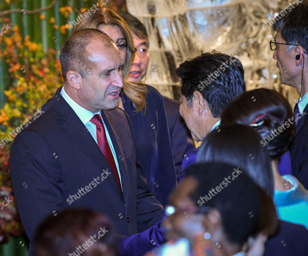 President of Bulgaria Rumen Radev (L) shakes hands with Prime Minister of Japan Shinzo Abe (R) at the cocktail party before a banquet for newly enthroned Emperor Naruhito, hosted by Japan's Prime Minister and his wife, at a hotel in Tokyo, Japan, 23 October 2019.