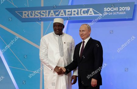 Russian President Vladimir Putin (R) shakes hands with Gambian President Adama Barrow (L) during an official welcome ceremony for heads of states and governments of member-states of Russia-Africa Summit in the Black sea resort of Sochi, Russia, 23 October 2019. The Russia-Africa Summit and Economic Forum take place on 23-24 October 2019.