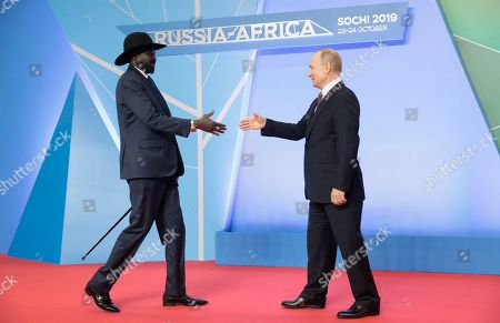 Russian President Vladimir Putin (R) shakes hands with South Sudanese President Salva Kiir Mayardit (L) during an official welcome ceremony for heads of states and governments of member-states of Russia-Africa Summit in the Black sea resort of Sochi, Russia, 23 October 2019. The Russia-Africa Summit and Economic Forum take place on 23-24 October 2019.