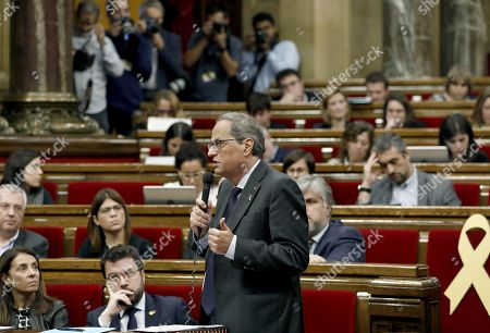 Catalan regional President Quim Torra (C) delivers a speech during question time at the regional Parliament in Barcelona, Spain, 23 October 2019. It is the first question time at the regional Parliament after a week of clashes between police and protesters against the Supreme's Court sentence to Catalan regional leaders.