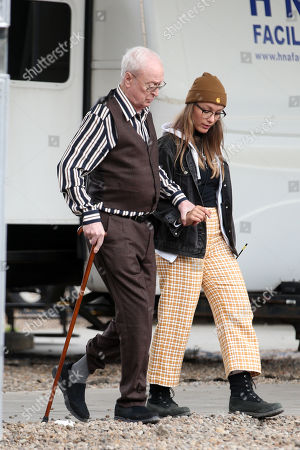 Stock Photo of Sir Michael Caine on set filming 'Twist'