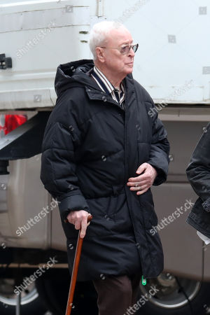 Stock Picture of Sir Michael Caine on set filming 'Twist'