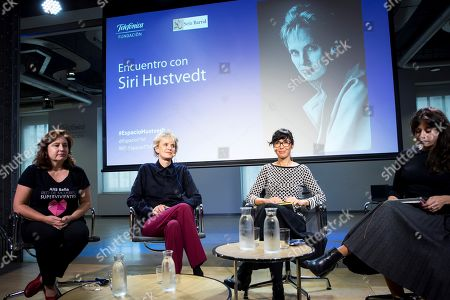 Stock Picture of US writer winner of the 2019 Princess of Asturias Literature Award, Siri Hustvedt (2R), Spanish feminist activist Ana Bella Estevez (L) and Spanish writers Edurne Portela (2R) and Isabel Valdes (L) take part in a debate on feminism at Telefonica Foundation in Madrid, Spain, 23 October 2019.
