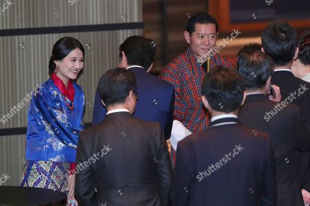 Bhutan's King Jigme Khesar Namgyal Wangchuck, rear right, and Queen Jetsun Pema are welcomed as they attend a banquet to celebrate the enthronement of the new Emperor Naruhito, in Tokyo