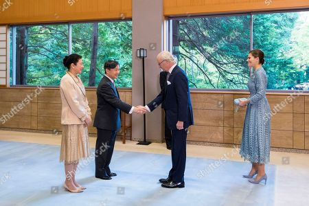 In this photo released from the Imperial Household Agency of Japan, Japan's Emperor Naruhito, center left, and Empress Masako, left, welcome Sweden's King Carl XVI Gustaf and his daughter Crown Princess Victoria for a tea party at the Akasaka Palace in Tokyo