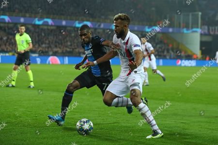 PSG's Eric Maxim Choupo-Moting, left, vies for the ball with Brugge's Clinton Mata during Champions League Group A soccer match between Club Brugge and Paris Saint Germain at the Jan Breydel stadium in Bruges, Belgium