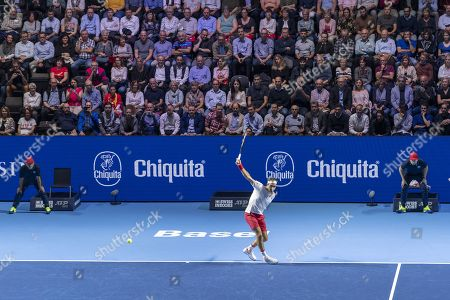 Stock Picture of Switzerland's Roger Federer returns a ball to Moldova's Radu Albot during their second round match at the Swiss Indoors tennis tournament at the St. Jakobshalle in Basel, Switzerland, on Wednesday, October 23, 2019.