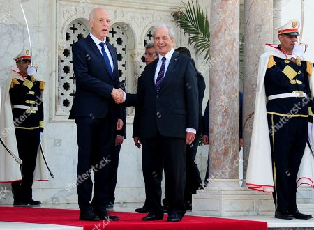 Newly elected Tunisian President Kais Saied and outgoing interim President President Mohamed Ennaceur during the hand over ceremony, in Tunis, . Tunisians elected former law professor Kais Saied as president earlier this month to replace President Beji Caid Essebsi, who died in July