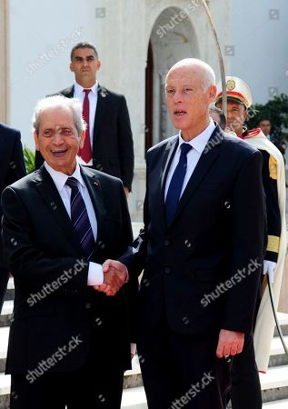 Newly elected Tunisian President Kais Saied and outgoing interim President President Mohamed Ennaceur during the hand over ceremony, in Tunis, Wednesday Oct.23, 2019. Tunisians elected former law professor Kais Saied as president earlier this month to replace President Beji Caid Essebsi, who died in July
