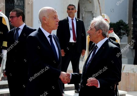 Newly elected Tunisian President Kais Saied, left, and outgoing interim President President Mohamed Ennaceur during the hand over ceremony, in Tunis, Wednesday Oct.23, 2019. Tunisians elected former law professor Kais Saied as president earlier this month to replace President Beji Caid Essebsi, who died in July
