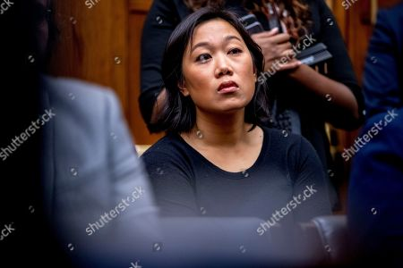 Facebook CEO Mark Zuckerberg's wife Priscilla Chan sits in the audience as he testifies before a House Financial Services Committee hearing on Capitol Hill in Washington, on Facebook's impact on the financial services and housing sectors