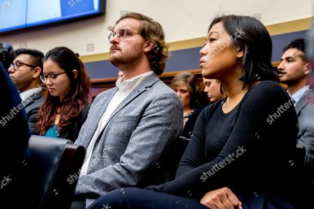 Facebook CEO Mark Zuckerberg's wife Priscilla Chan, right, sits in the audience as he testifies before a House Financial Services Committee hearing on Capitol Hill in Washington, on Facebook's impact on the financial services and housing sectors