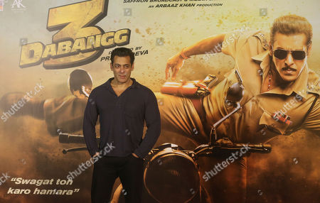 """Bollywood actor Salman Khan stands for photographs during the trailer launch of his upcoming film """"Dabangg 3"""", or Fearless 3, in Mumbai, India, . Dabangg 3, a story of a fearless police officer, is scheduled for release on Dec. 20"""