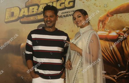 """Sonakshi Sinha, Prabhu Deva. Bollywood actress Sonakshi Sinha, right, stands with film director Prabhu Deva during the trailer launch of their upcoming film """"Dabangg 3"""", or Fearless 3, in Mumbai, India, . Dabangg 3, a story of a fearless police officer, is scheduled for release on Dec. 20"""