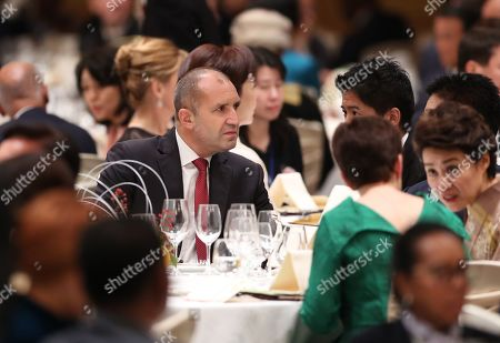 President of Bulgaria Rumen Radev (C) attends the banquet hosted by the Prime Minister of Japan Shinzo Abe and his spouse in Tokyo, Japan, 23 October 2019.