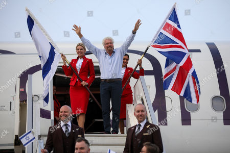 Richard Branson waves as he arrives to Ben Gurion airport to inaugurate the start of Virgin Atlantic airline in Israel, in Tel Aviv, Israel