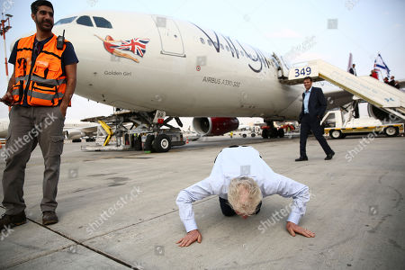Richard Branson kiss the ground as he arrive to Ben Gurion airport to inaugurate the start of Virgin Atlantic airline in Israel, in Tel Aviv, Israel