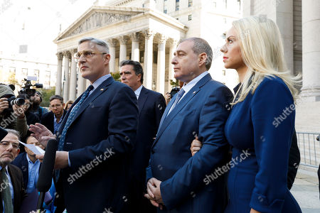 Businessman Lev Parnas (C), an associate of US President Donald Trump's personal lawyer, Rudy Giuliani, stands with his wife Svetlana (R) and his attorneys following an arraignment hearing at an US Federal Courthouse in New York, New York, USA, 23 October 2019. Parnas, and another man, Igor Fruman, were arrested on 10 October for alleged campaign finance violations.