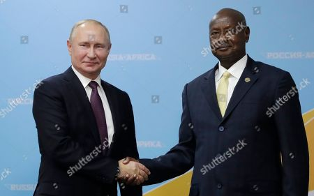 Russian President Vladimir Putin (L) and Ugandan President Yoweri Museveni (R) shake hands during their meeting  on the sidelines of the Russia-Africa Summit and Economic Forum in the Black sea resort of Sochi, Russia, 23 October 2019. The Russia-Africa Summit and Economic Forum take place on 23-24 October 2019.